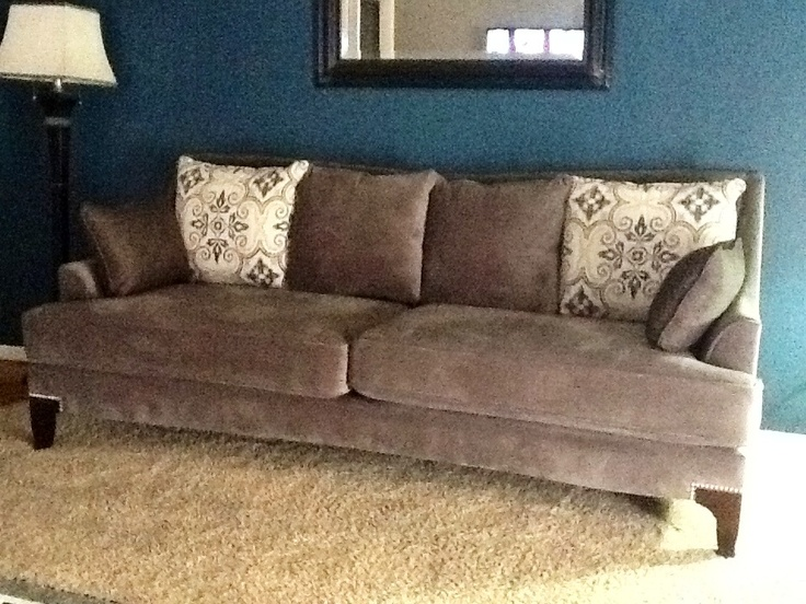 Gray Couch And Teal Wall