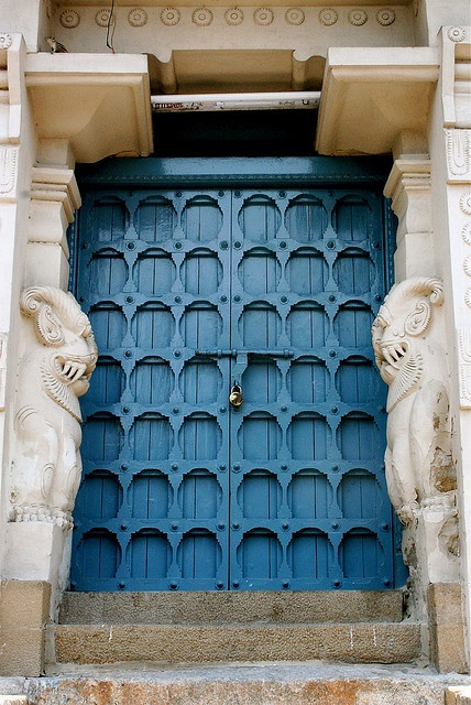 "~ blue wooden doors with carved stone ""guards"" at a Hindu Temple, India ~"