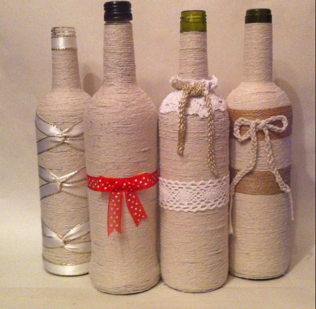 Recycled wine bottles Decorated with twine.