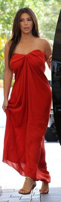 Who made Kim Kardashian's red strapless maxi dress and gold sandals that she wore in Miami?