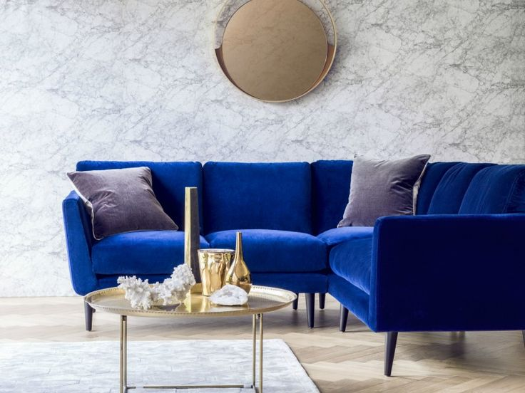 The small Holly corner sofa in Prussian Blue cotton matt velvet, £3,030