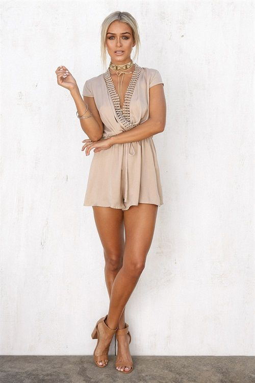 Made from a semi sheer silky fabric in a beige hue, the Angelika Chain Playsuit features a chain trim feature on neckline, tie up at waist and adorable cap sleeves. Dress it up with heels or dress it down with sandals! Exclusively designed by Sabo Skirt.