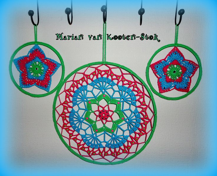 A mandala or dreamcatcher. Also nice as a wall decoration. For the little dreamcatchers I have used the middle of this pattern http://www.pinterest.com/pin/126734176987116529/ and for the great dreamcatcher/ mandala I used this pattern http://www.pinterest.com/pin/126734176988332693/