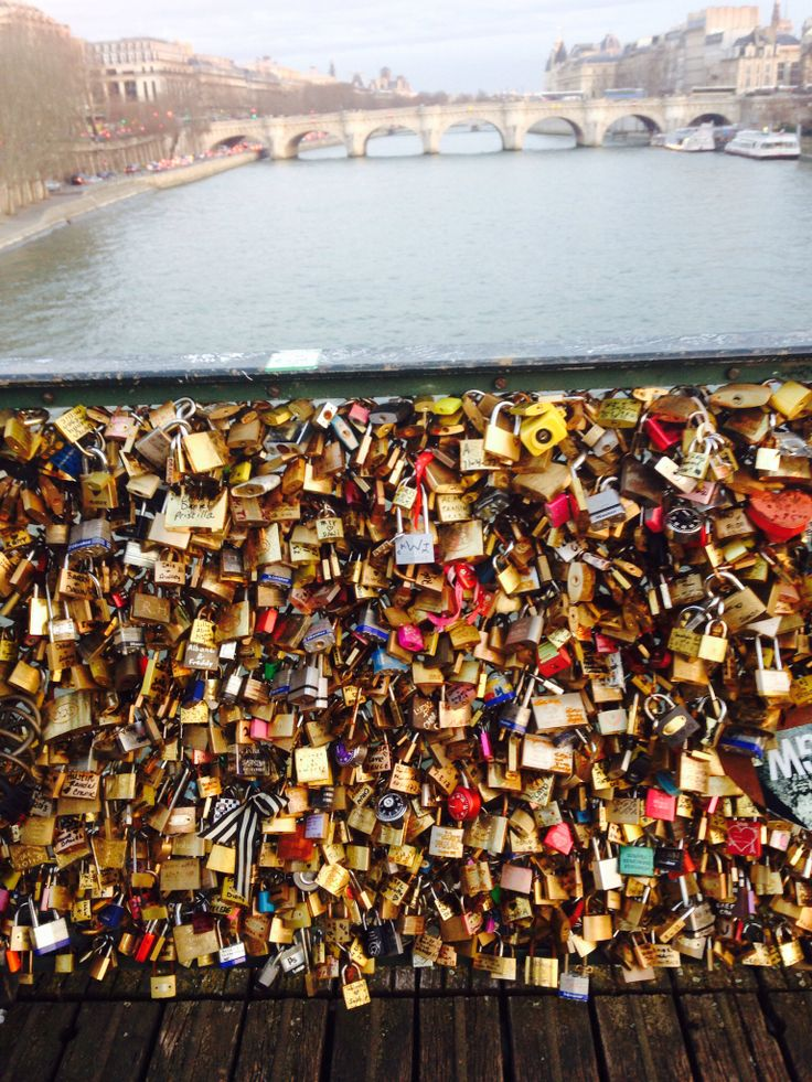 love lock bridge, Paris France. Couples attach a lock then throw the key in the water to symbolize their everlasting love