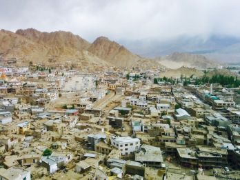 Leh, a high-desert city in the Himalayas, is the capital of the Leh region in northern India's Jammu and Kashmir state. Originally a stop for trading caravans, Leh is now known for its Buddhist sites and nearby trekking areas. Massive 17th-century Leh Palace, modeled on the Dalai Lama's former home (Tibet's Potala Palace), overlooks the old town's bazaar and mazelike lanes.