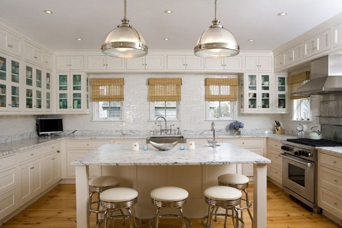 Stunning U shaped kitchen with floor to ceiling white kitchen cabinets, ...