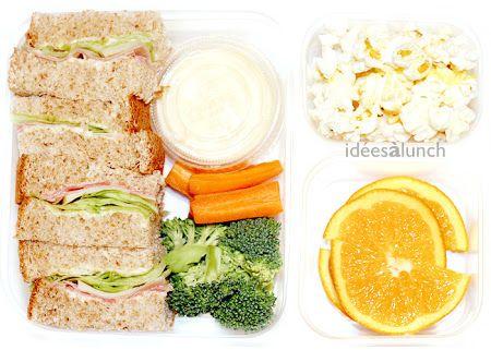 Pain, moutarde, laitue, jambon, fromage, carotte, broccoli, trempette.   Maïs souflé.   Orange.