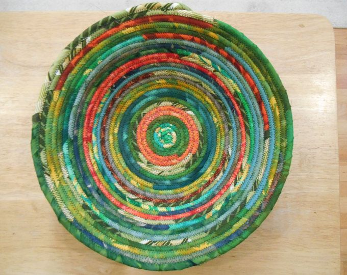 Green and yellow and orange fabric-wrapped clothesline bowl