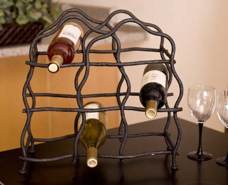 Forged Iron 8 Bottle Wine Rack Forged Iron Accessories - Hand forged iron wine rack with natural grapevine design, holds 8 bottles of your favorite wine. The black iron is blacksmith built and every hammer blow brings a specific signature of the craftsman.