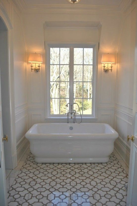 Bathroom with stand alone tub. I like that you wouldn't have to mop under this one.