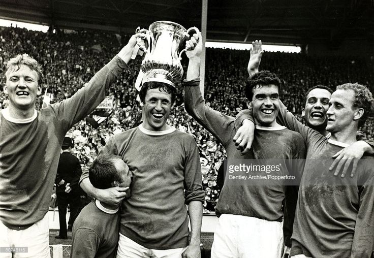 15th May 1966, 1966 F,A, Cup Final, Wembley, Everton 3, v Sheffield Wednesday, 2, Everton celebrate with the F,A,Cup after coming back from 2 goals down to win 3-2, Left-right, Jimmy Gabriel, Ray Wilson, Brian Harris (trophy on head), Alex Scott, Mike Trebilcock, Alex Young