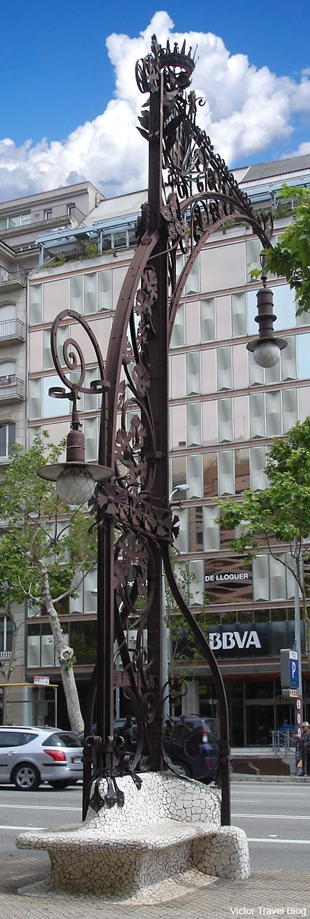 Streetlight. The first order of Antoni Gaudi. Barcelona, Spain.