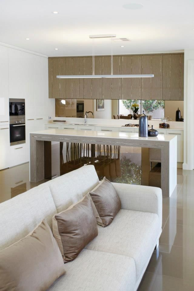 Mirror, mirror.... The laminate cupboards and island bench surround frame the mirrored finishes beautifully...