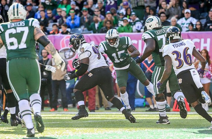 Jets vs. Ravens:   October 23, 2016  -  24-16, Jets   -      New York Jets wide receiver Brandon Marshall (15) strips the ball from Baltimore Ravens defensive end Timmy Jernigan (99) who recovered a Jets fumble on a wild, 2-fumble play in the third quarter as the Jets defeat the Ravens, 24-16, at MetLife Stadium. Marshall ended up with the ball. 10/23/16 (Andrew Mills | NJ Advance Media for NJ.com)