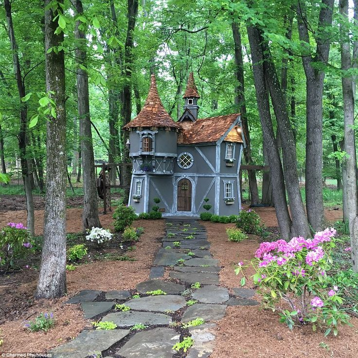 Fit for a princess: Baseball player Ryan Zimmerman, who of the Washington Nationals, splashed out $50,000 (£40,000) to have this custom-made castle installed in his back garden for his two-year-old daughter, Mackenzie. A flagstone path leads to the enchanted looking building, which boasts a swirling side and its very own  water wheel. Built by: Charmed Playhouses