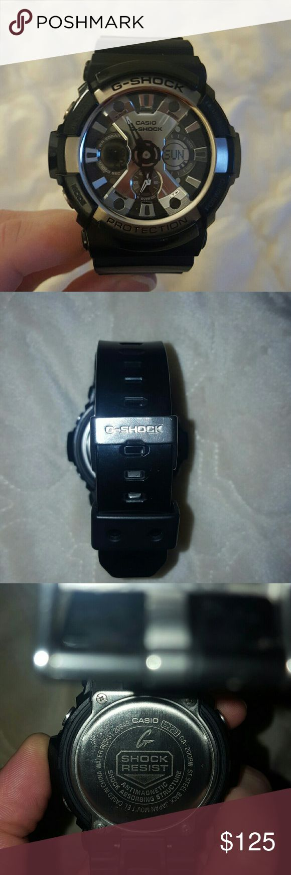 G-Shock Men's Watch (Black) Men's G-Shock Watch (black) A rough and rugged watch from G-Shock that is anything but basic. Featuring a mechanical dial with analog and digital capabilities and a black strap with a buckle closure. Case size: 52mm Water resistant to 200m Imported  Minimal wear-- just like new!  **Will be shipped in original case and box with user's guide and international warranty card included!**  All reasonable offers will be considered! G-Shock Accessories Watches