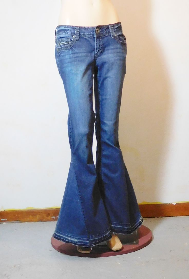 Super wide upcycled bell bottom jeans.  Low waist, hip hugger.  Size 7/8.  70s style hippie clothes