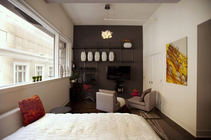 Tiny apartment floor space showing bed end and combined living space