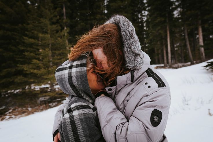 Keeping each other warm in the snow. Taken in Kananaskis, Rocky Mountains, Canada. Photo by Benjamin Stuart Photography #weddingphotography #rockies #canada #love #engagementshoot #soontobemrandmrs