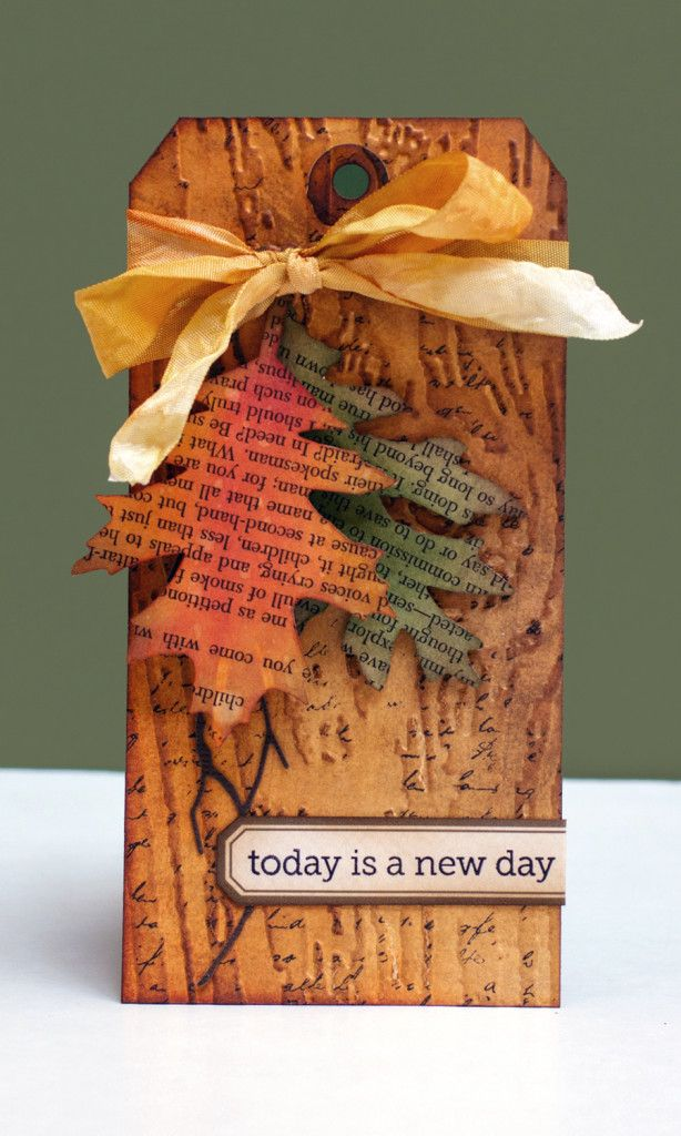 Rustic tag. Woodgrain embossed base, MB branch die, sponged, tattered leaves die cuts, small label for sentiment, burnt ribbon.