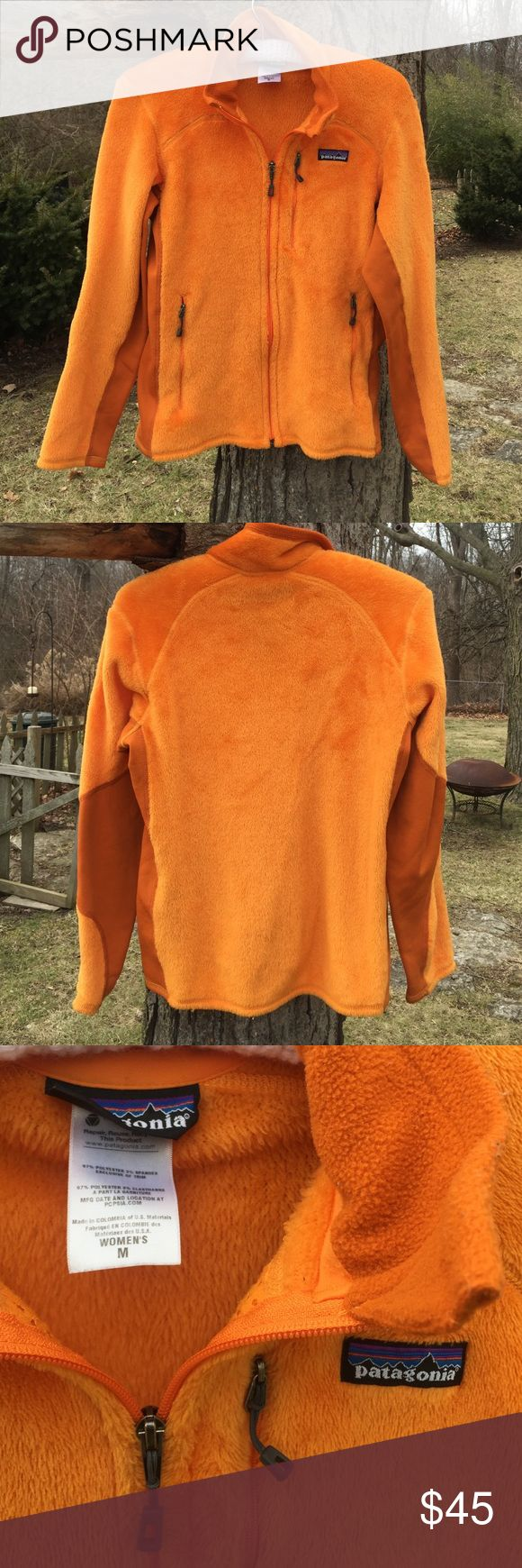 Patagonia Zip-Up Fleece Woman's medium zip-up Patagonia in bright orange! 97%Polyester/3%Spandex. Inside shows mesh liner on both sides of zipper. Super warm and comfortable! Patagonia Jackets & Coats