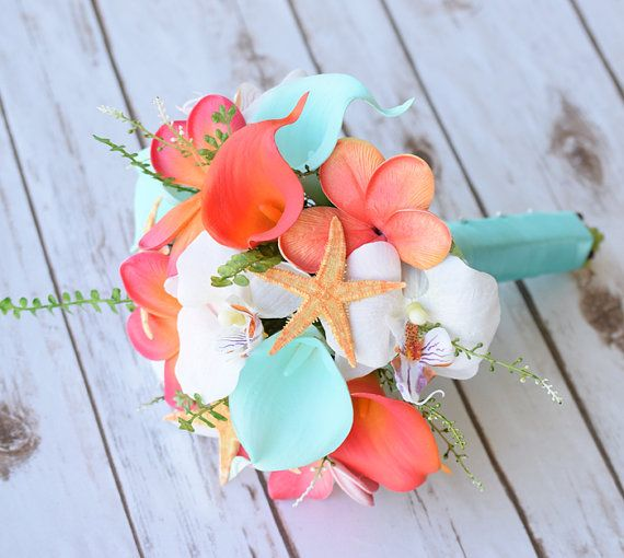 This is a beautiful -almost fresh- Coral Orange and Aqua Turquoise Mint Teal Mix of Orchids, Calla Lilies and Plumerias Natural Touch Wedding Bouquet, made with the most realistic silk flowers available. Finished with a Natural Starfish.  You can get this bouquet in 8 Wide or 9 Wide. The picture shows the 9 Wide version. For the Ribbon choices, the sky is the limit! Send us a picture of your colors and well match is as close as possible. You can find matching bouquets here: Larger…