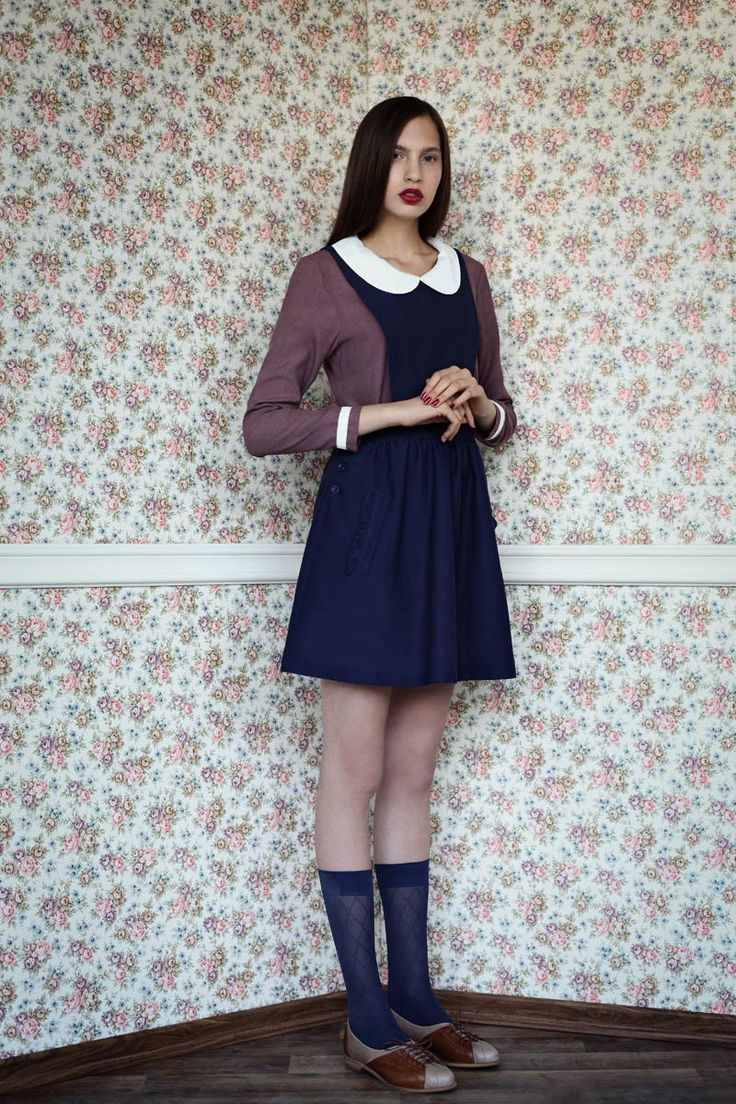 I'm a sucker for dresses that look like old-timey school uniforms. A ribbon bow and a bob haircut would make this even better.