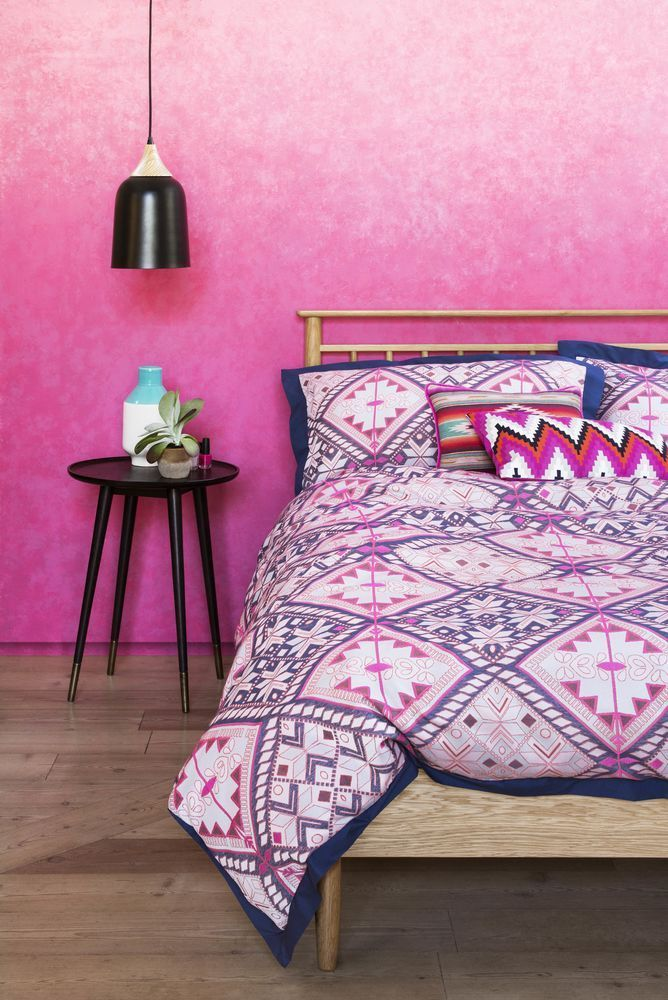 Pinterest-worthy bedrooms: ideas and inspiration to create your dream sanctuary. Choose a bed with a contemporary frame as the foundation to the room and then layer bedlinen in your colour palette. Keep other accessories and furniture simple to allow the bold patterns to take centre stage. (Photo credit: Marks & Spencer).