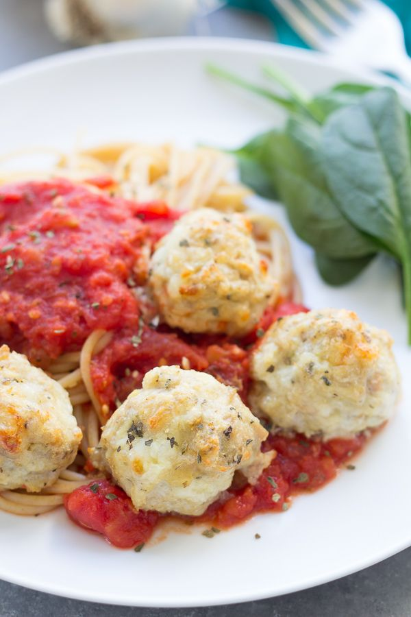 8 ounces whole wheat pasta, any shape For the meatballs: 1 pound ground chicken 1 large egg ½ cup panko crumbs ½ cup grated Parmesan cheese ½ cup grated mozzarella cheese 1 large clove garlic, minced ½ teaspoon dried oregano ½ teaspoon dried basil ¼ teaspoon salt ⅛ teaspoon pepper For the tomato sauce: 1 tablespoon olive oil ½ cup finely chopped onion 3 cloves garlic, minced 28 ounce can crushed tomatoes 14.5 ounce can petite diced tomatoes 1 teaspoon dried oregano 1 teaspoon dried Italian…
