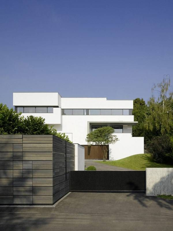 Minimalist Exterior House Design Ideas: Minimalist House Exterior In White With Stone Fence