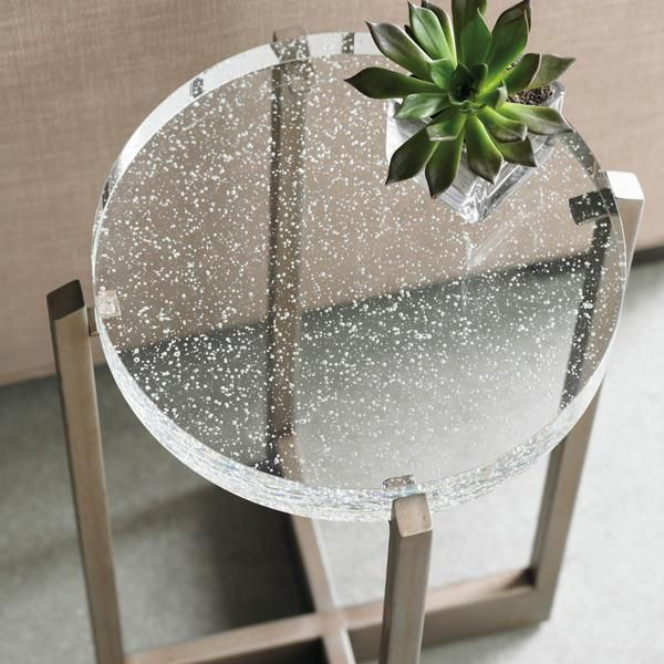 Product Name: Fizz by Caracole. Every chair needs an accompanying table. The perfect choice to add pizazz and function to a room. A graceful and graphic metal base cradles a statement-making cast glass top. Available exclusively at Space Design Collective in India. www.spacedesigncollective.com