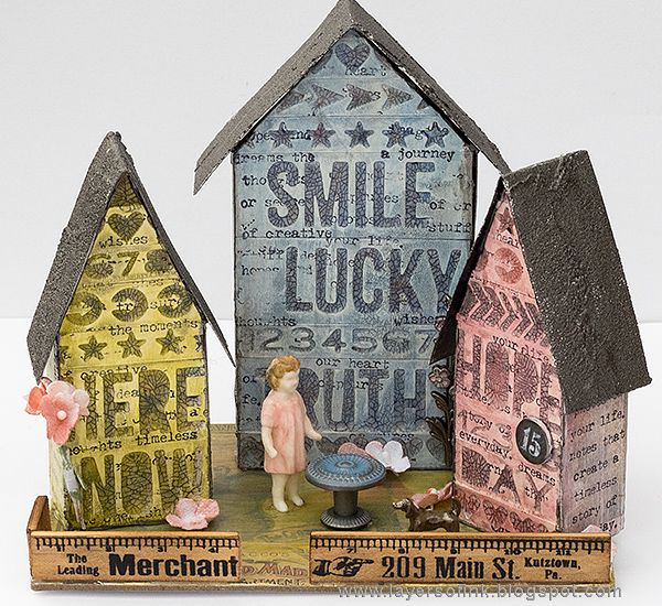 Layers of ink - Word Village Tutorial by Anna-Karin. Tiny Houses made with Sizzix dies by Tim Holtz. Paints and medium by Ranger Ink and stamps by Stamper's Anonymous. Tim Holtz ideaology embellishments.