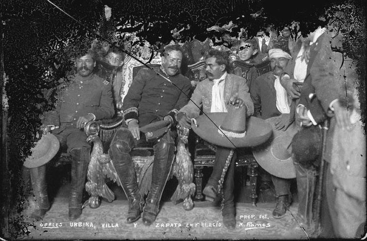 Manuel Ramos - Pancho Villa on the presidential chair, on his left Emiliano Zapata. December 1914.