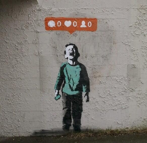 This is a very interesting visual metaphor by the very famous street artist Banksy. Banksy has used social media (instagram) in order to express his ideas that no one cares about the crying children in the world. He expresses this through the Instagram bar on top of the childs head which claims there to be no likes, no comments and no follows.