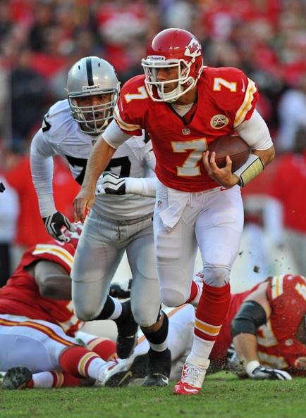 Quarterback Matt Cassel #7 of the Kansas City Chiefs scrambles away form defensive end Matt Shaughnessy #77 of the Oakland Raiders during the second quarter on October 28, 2012 at Arrowhead Stadium in Kansas City, Missouri.
