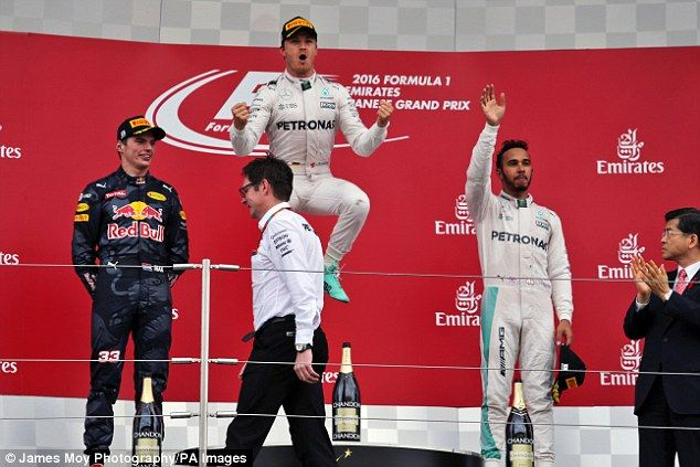 Nico Rosberg celebrates victory in the Japanese Grand Prix as Lewis Hamilton finished third