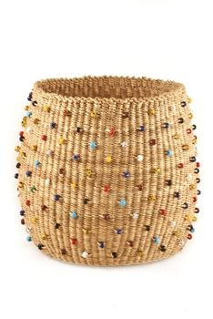 Weavers in Ghana's Bolgatanga region utilize durable natural fibers to create beautiful baskets that will remain useful for years to come. Our Beachcomber baskets are adorned with colorful glass trade beads.