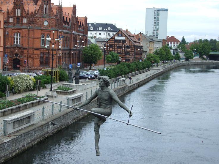 """Bydgoszcz, Poland. """"Przechodzacy przez rzeke"""". Man crossing the river."""