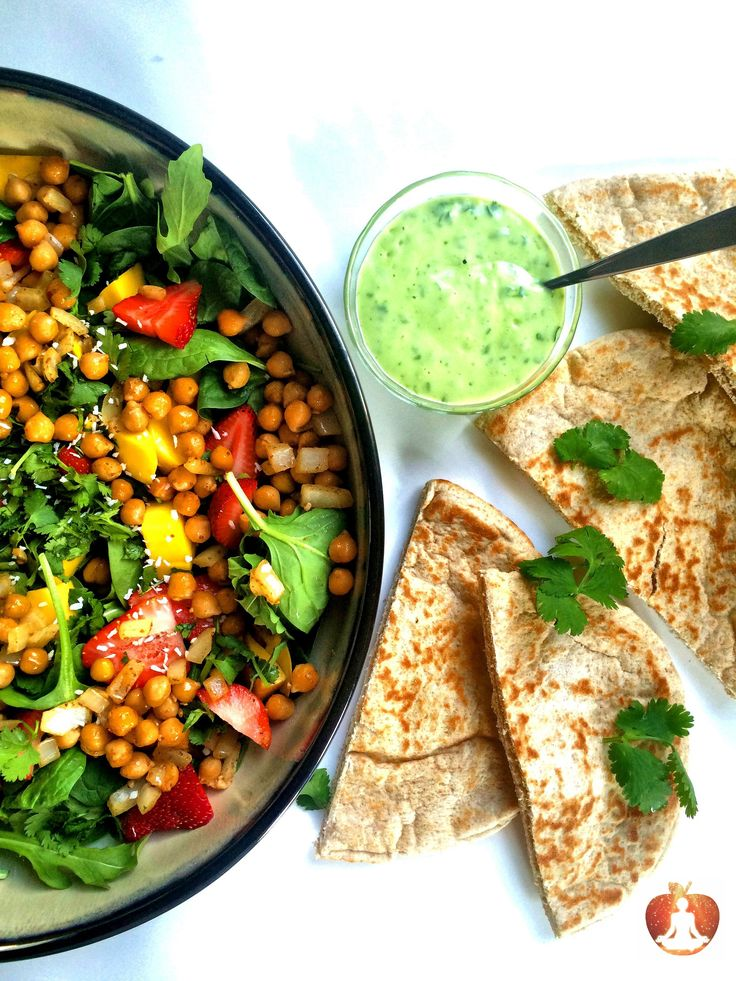 What a better way to turn down the heat of this delicious chickpea bowl than to serve it as a salad, stuffed in a fresh pita with mango and a sweet a