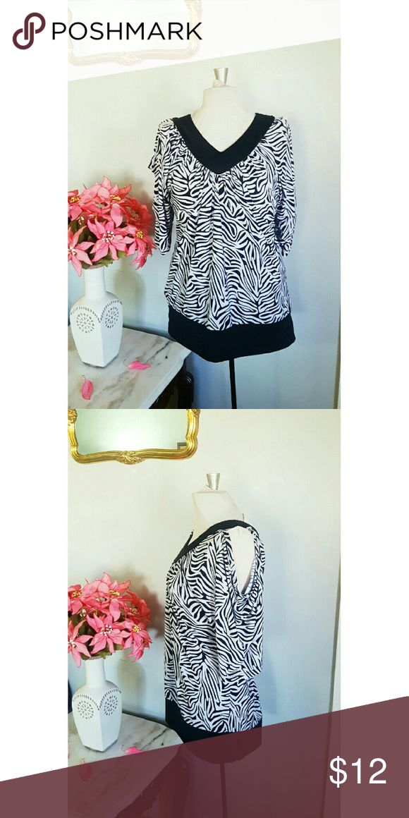 Gold Flava Cold Shoulder Blouse Cold shoulder style blouse. In great condition,  no sign of wear, the only flaw IMO is the white parts are not as bright, more if a dull white. Tag reads size 24 , measurements upon request  91% polyester  9% licra Tops Blouses