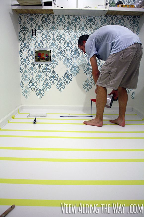 Before and after laundry room. How to paint vinyl/laminate floors! It's easy and inexpensive! Click through for the full tutorial!