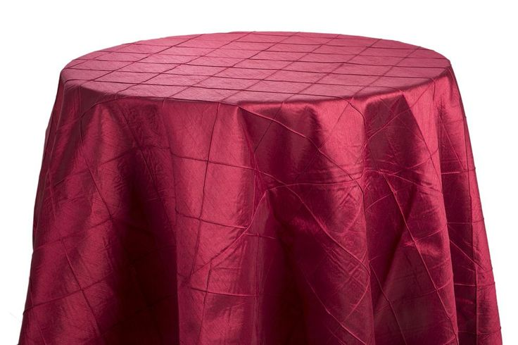 "120"" diameter red pintuck linen; floor length for a 60"" round, 29"" high table or for a 30"" round, 42"" high cocktail table. ($26.75 each)"