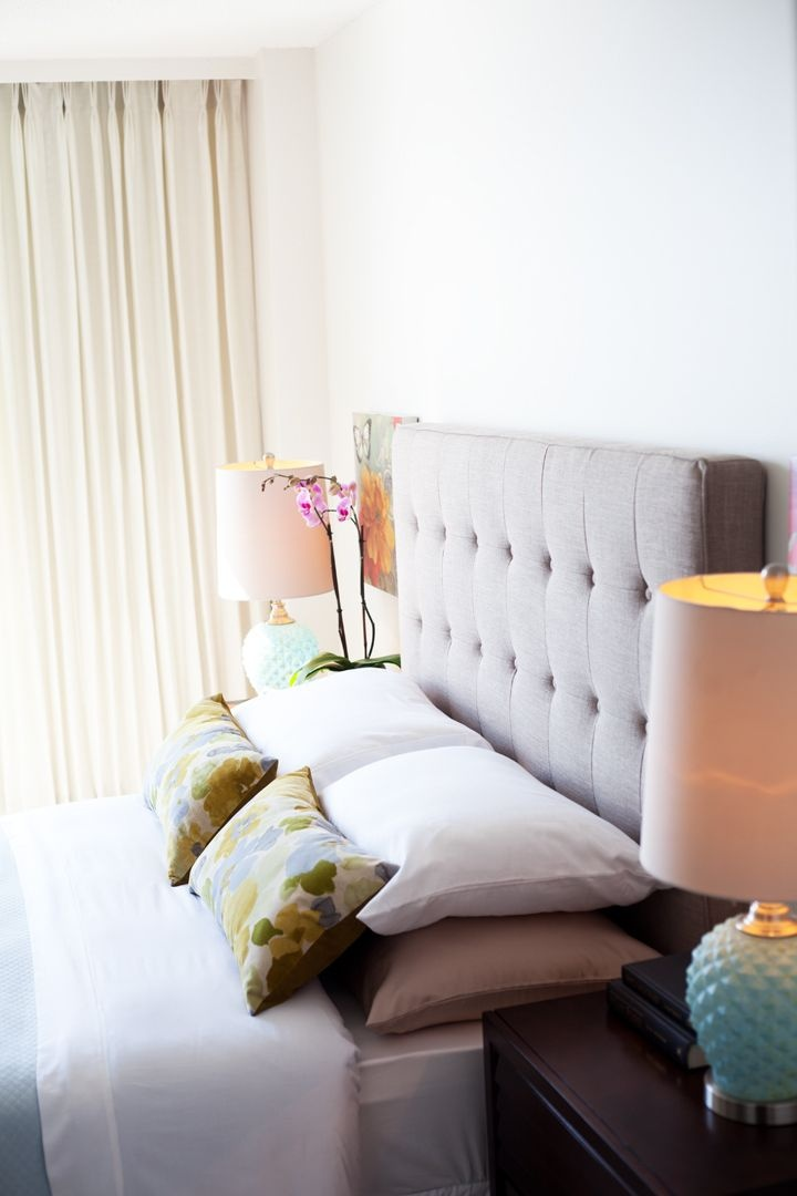 pretty master bedroom with some colourful accents