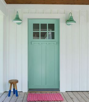 A mint green front door might just be the most cheerful way to welcome guests.