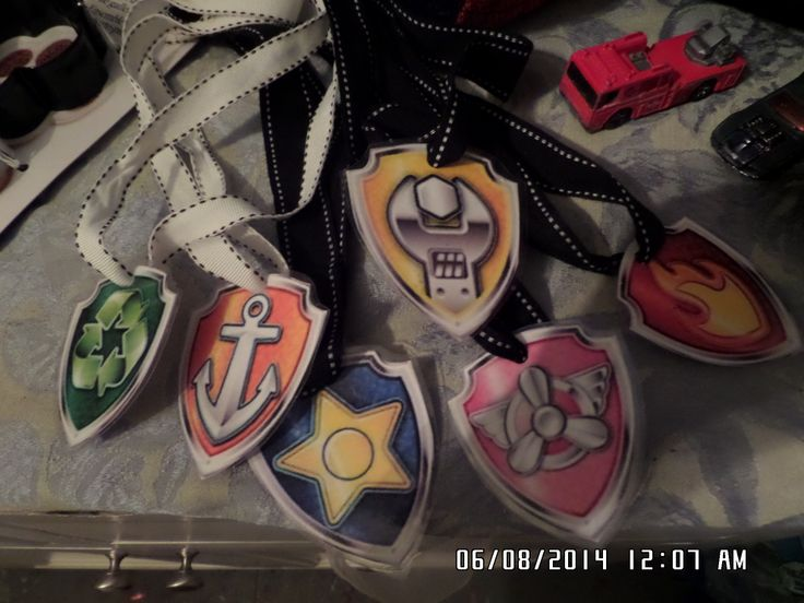 I made badges for the kids to wear during the games . I printed the badges from Nick jr. . I laminated them and then put the badges on clothe ribbons .