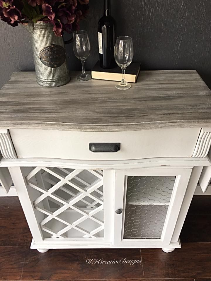 Farmhouse Style Wine Bar Cabinet In Antique White Chicken Wire And Faux Driftwood Finish On The Top Wine Bar Cabinet Bar Cabinet Decor