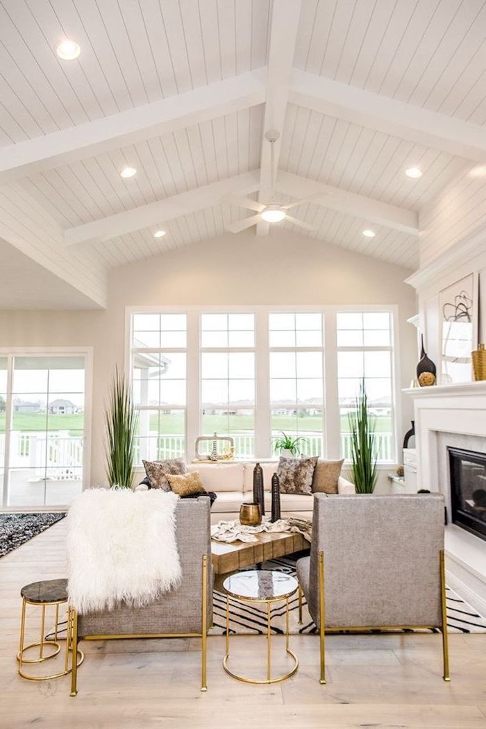 Grey Armchairs Brass Tables Cathedral Ceiling White Aesthetic Fireplace Cathedral Ceiling Living Room White Paneling Vaulted Ceiling Living Room