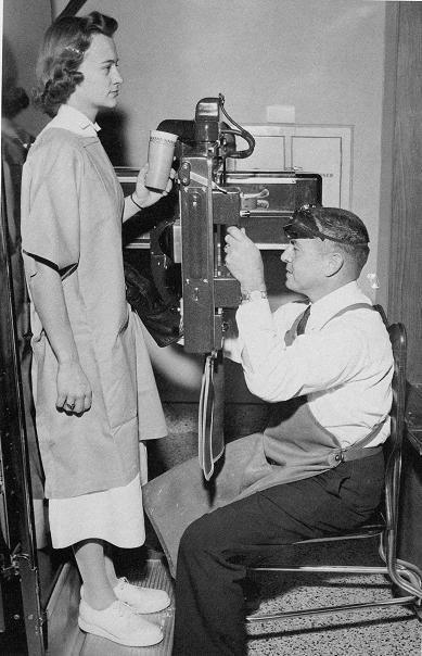 Dr. Robert Jackson, associate radiologist, demonstrates fluoroscopic machine. Rex on Saint Mary's Street c. 1960.