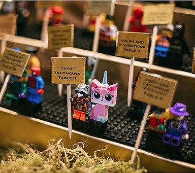 Kristen and Bryan's New Year's Eve wedding had a whole lotta fun, geeky details, but we are loving the LEGO minifig place cards. They're easy to make, easy to grab and take, and t…
