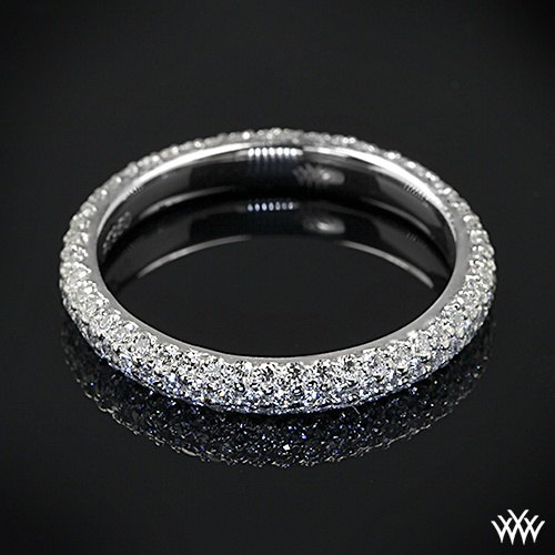 custom wedding ring is set in platinum and is a